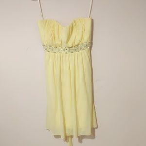 Strapless yellow empire waist dress